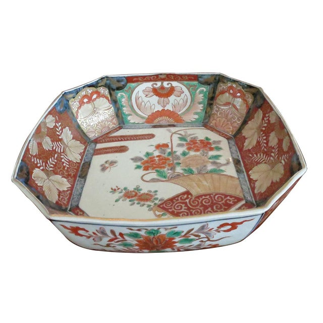 A fine octagonal Japanese Imari porcelain bowl, Meiji period. Decorated in typical traditional imari colors of red, cobalt...