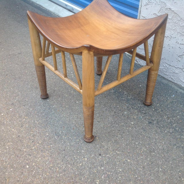 Modern mid-century style ottoman /stool. The modern stool is made os beech and has a washed walnut finish. The stool is in...