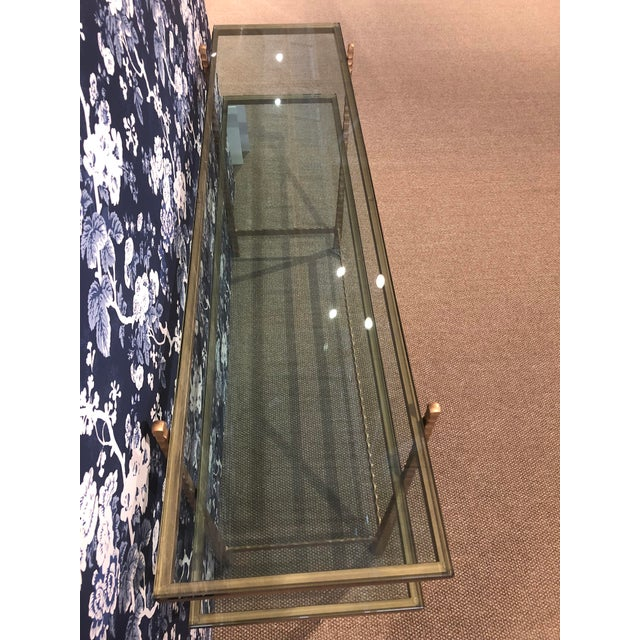 Stamford CT floor sample Michel console table. Features metal and glass, two shelves and Tuscan gold finish