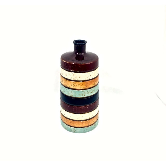 Midcentury-style ceramic vase with rings design in turquoise and earth tones with a speckled finish. Good condition.