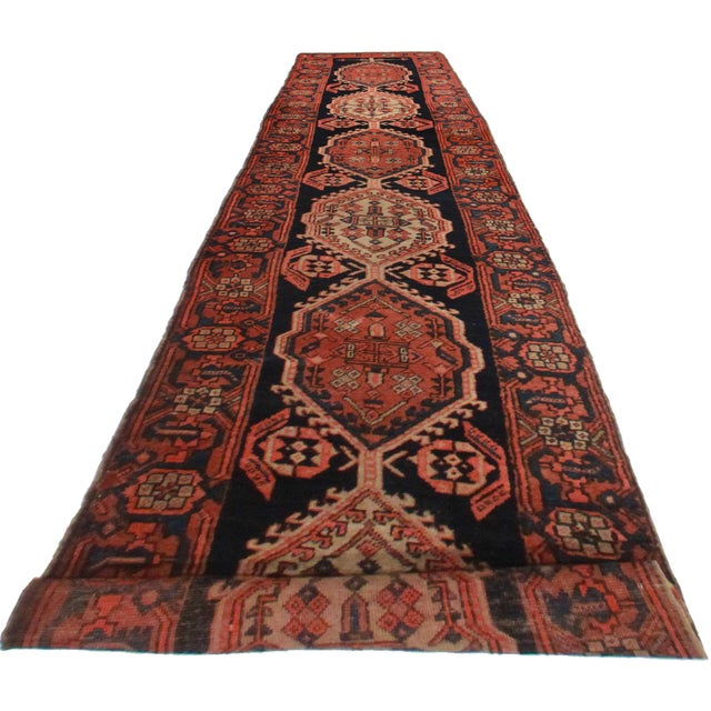 Offered is this antique Persian Sarab runner. Hand-knotted from wool. Lovely geometric designs.