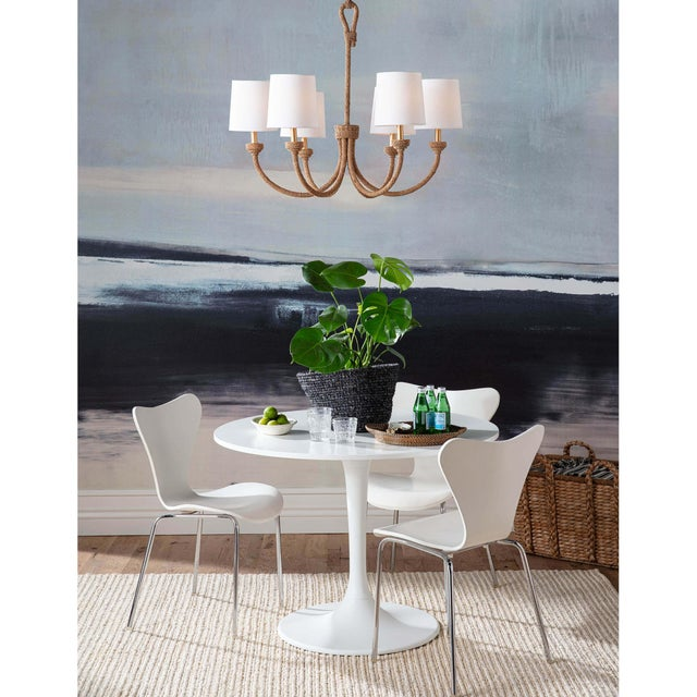 "Natural woven rattan provides a ""washed ashore"" look on the Bimini chandelier. Looped detailing also provides a nautical..."