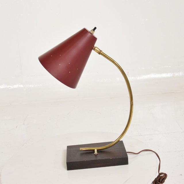 For your consideration, a Mid Century Modern Italian Desk Task Lamp. Unmarked, Red shade with wood base and brass...