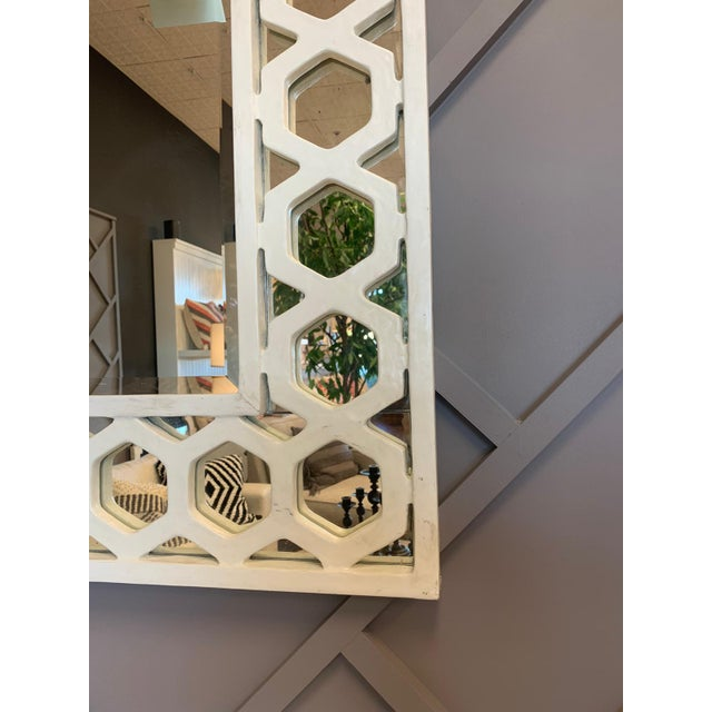 A fretwork mirror inspired by vintage architectural carvings. Frame Finishes: Smooth White Gesso Mirror: Plain Mirror with...