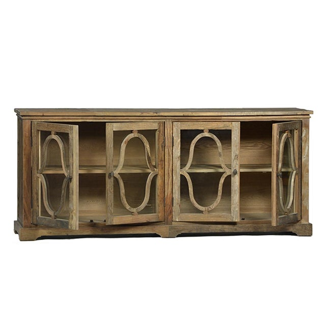 Reclaimed old elm wood sideboard with a natural sealed finish. Glass panels in doors with carved wood overlay. Includes on...