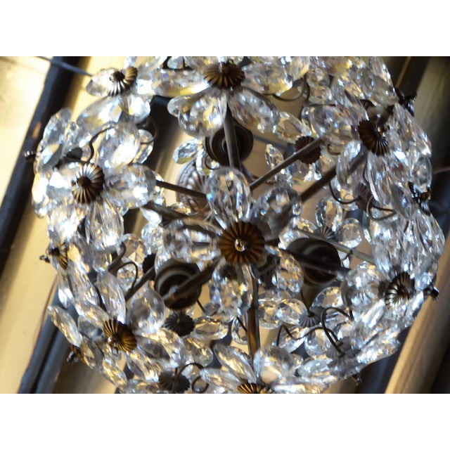 Precious 1920s era Baguès ball form chandelier of crystal petal floral design. With four internal candelabra bulb lights....