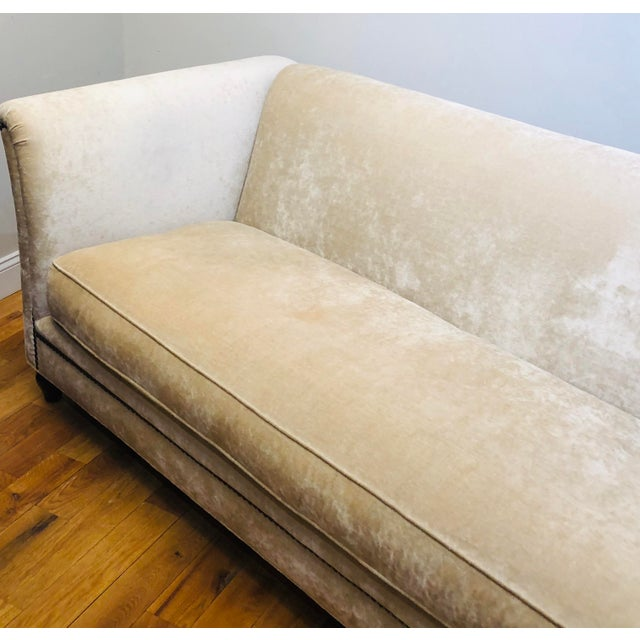 This beige upholstered sofa by Dapha Upholstery has a mid-century style with a modern flair. Its features include solid...