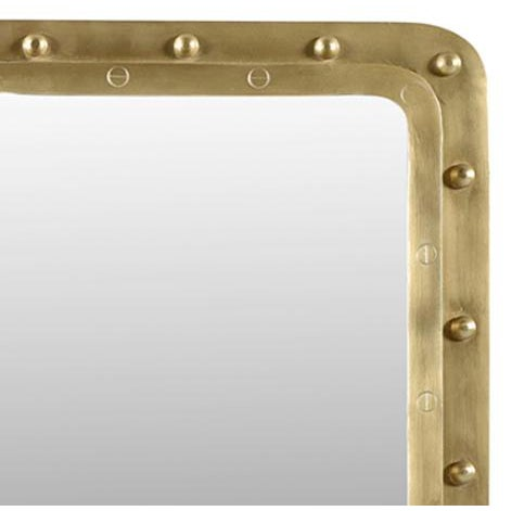 Square mirror with a unique brass rivet frame. This industrial contemporary mirror with a touch of nautical edge will look...