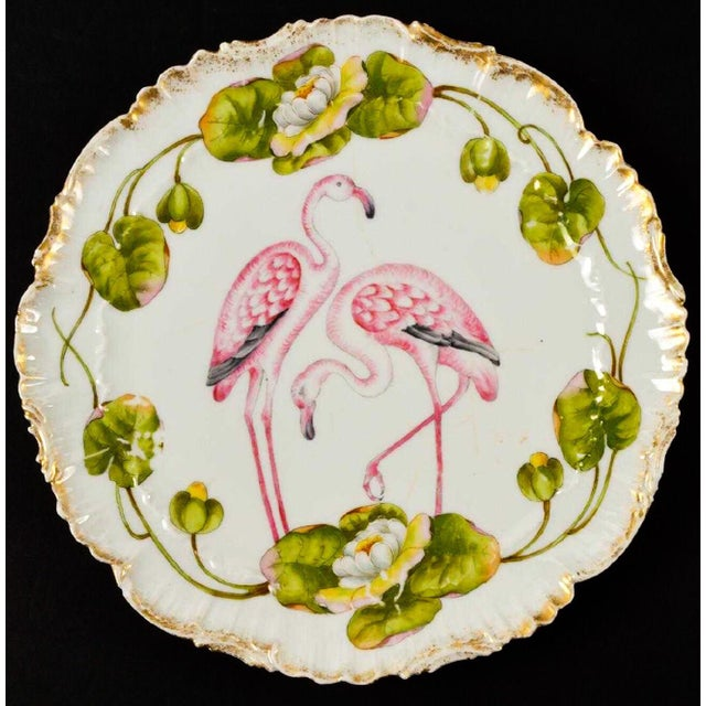 Set of eleven German Schierholz porcelain plates depecting pink flamingos. They are marked, and some have fading.