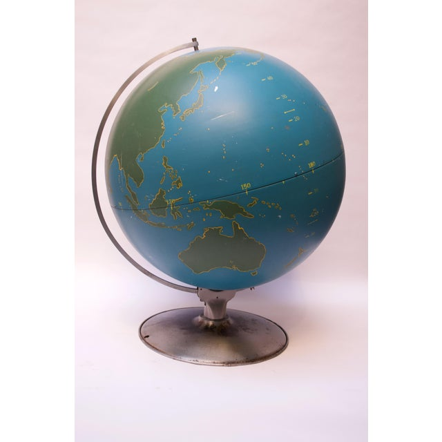 Machine Age-style A.J. Nystrom of Chicago Military or Activity Globe composed of a spun metal blue orb with green slated...