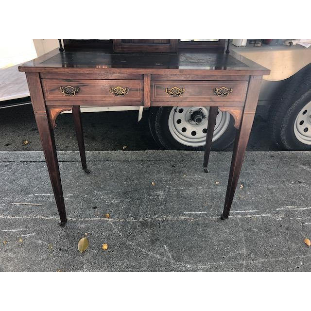 This is a very nice antique rosewood ladies writing desk made in England circa 1890. Its in very good condition with...