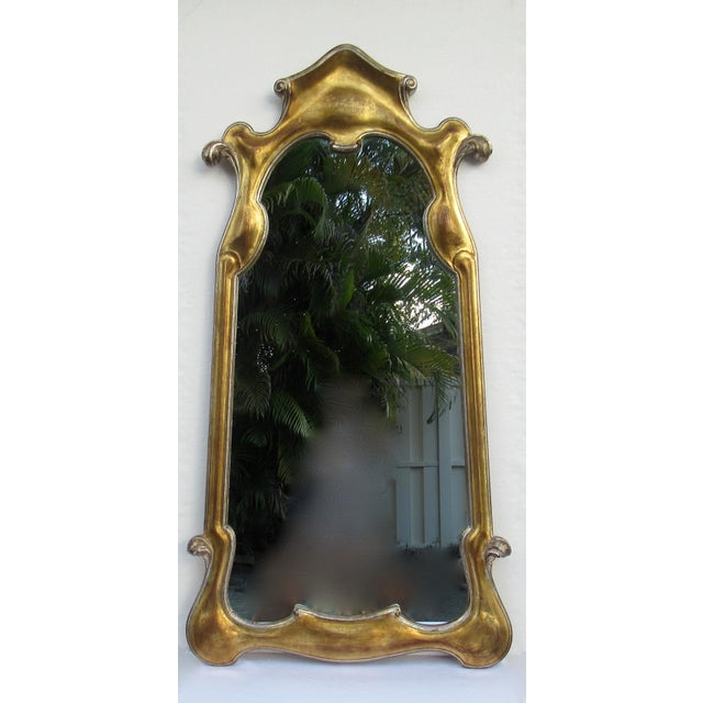 C.1950s-60s; Vintage, Hollywood Regency era, Dorothy Draper-style gilt gold and silver leaf, ornate and curved mirror,...