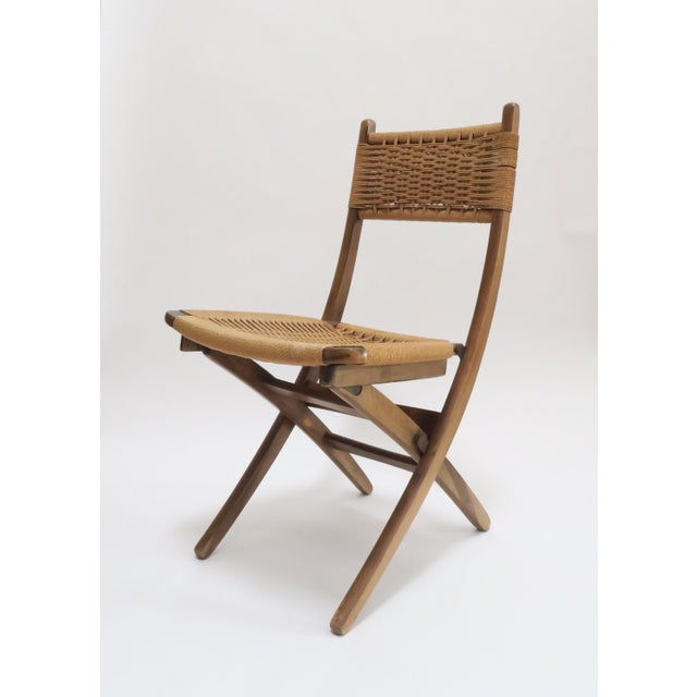 Danish Modern rope folding chair in style of Hans Wegner. In excellent condition, with all rope in tact and quite taut....