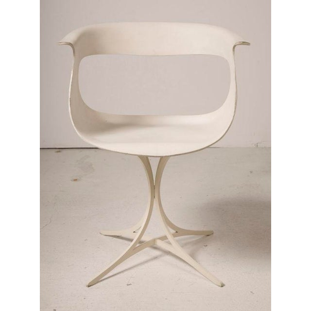 """A hip Lotus armchair mod. no. 115-LF from the """"Fiberglas Group"""" consisting of a molded free-form cut-out Fiberglas shell..."""