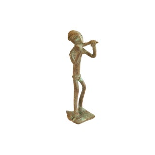 Vintage African Oxidized Copper Man Eating For Sale