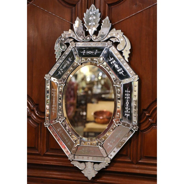 The overlay Venetian mirror was crafted in Italy, circa 1910, octagonal in shape, the wall piece features a large carved...