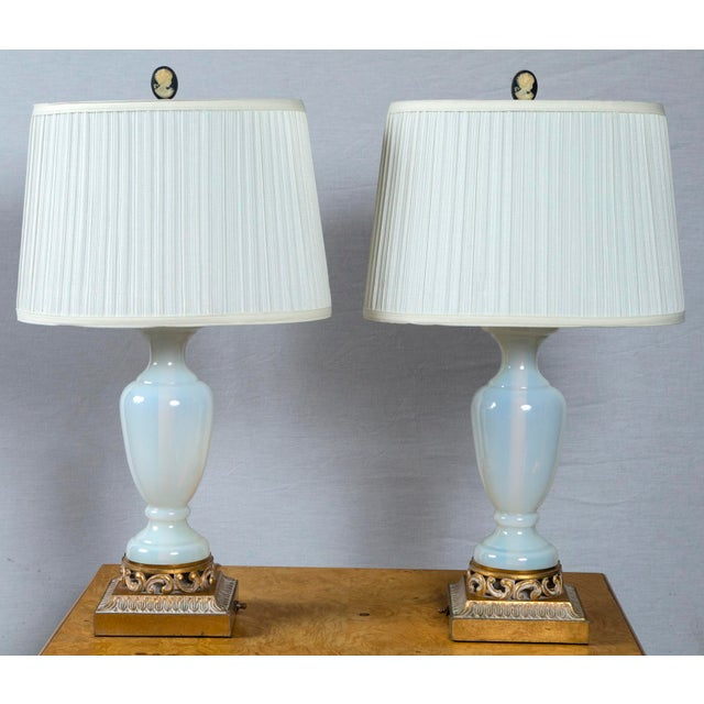 """A very fine quality pair of French opaline glass lamps with cameo finials and gilt base. Height to top of finial: 26""""..."""