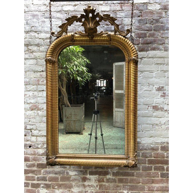 19th century mirror, gold leaf gilded with its original mirror-glass, Provenance France This 19th Century Mirror, with its...