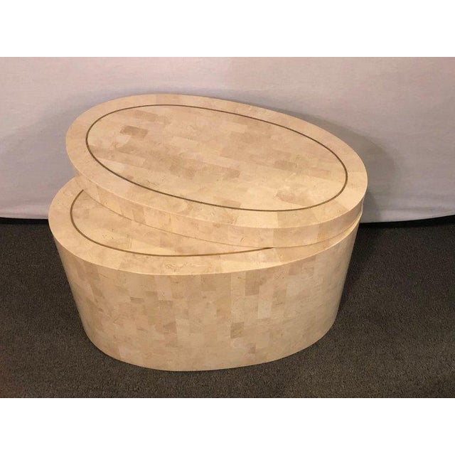 A Hollywood Regency tessellated bone swivel expanding coffee or end table in the manner of Enrique Garcel. The oval base...