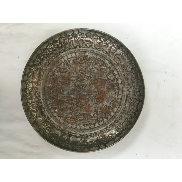 Antique Persian hand etched tinned copper rimmed plate depicting a hunt scene. Hanger attached on reverse.