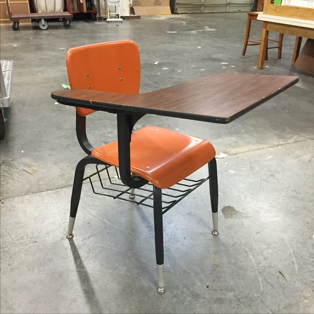Amazing vintage school desks complete with gum stuck to the bottom of the seats! Would be so cool in a coffee shop or...