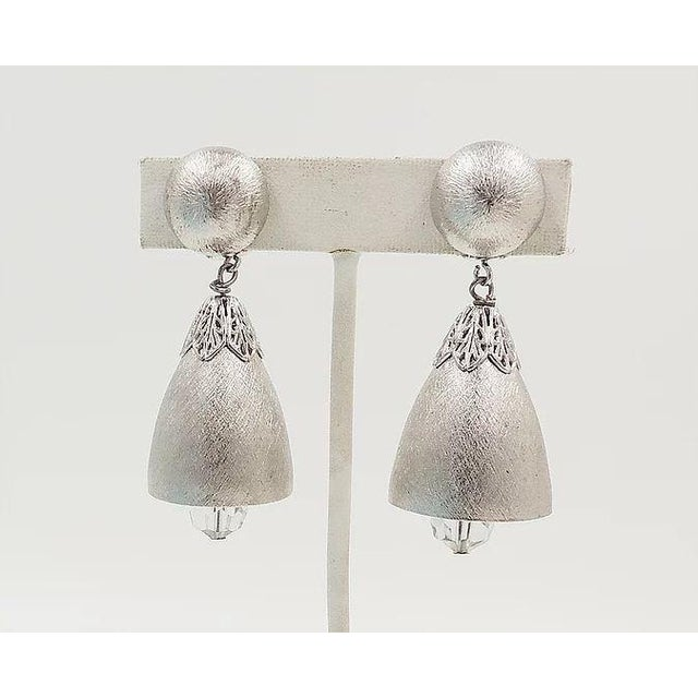 """1970s hatched silvertone with cut glass beads bells clip back earrings. Marked """"Napier."""" Earrings ring with movement...."""