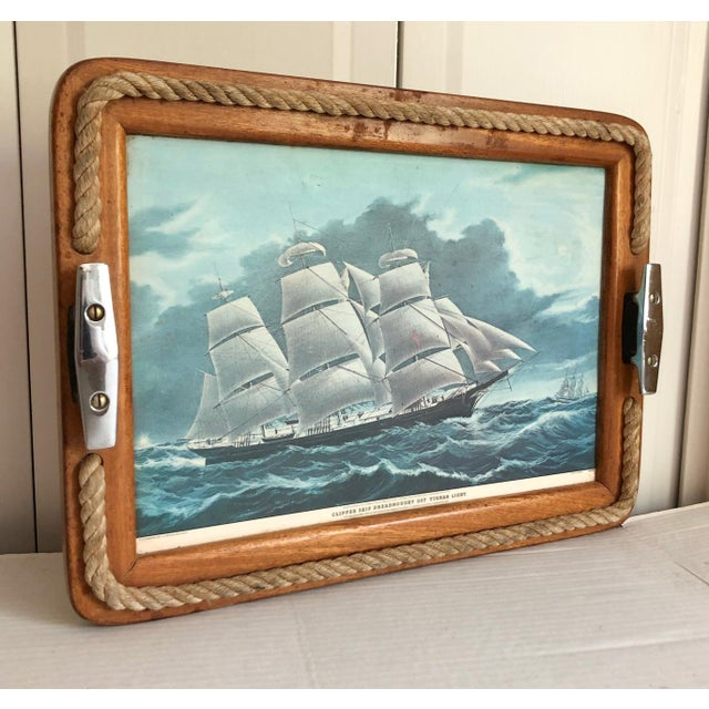 Wonderful vintage ocean clipper ship motif tray with a solid wood frame trimmed in real rope with two stainless steel...