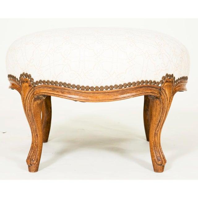 A Napoleon III walnut round stool, France circa 1850.