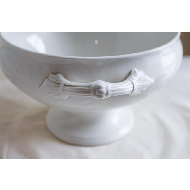Vintage French Lidded Ironstone Tureen A beautiful glazed, white ironstone tureen with a pedestal base that is perfect for...