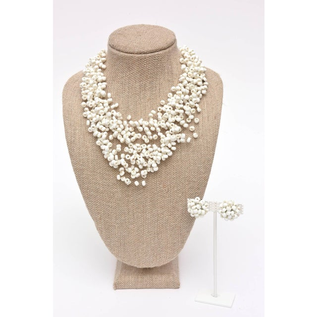 White Langani Multi Strand Beaded Necklace and Pair of Matching Clip Earrings For Sale - Image 8 of 10