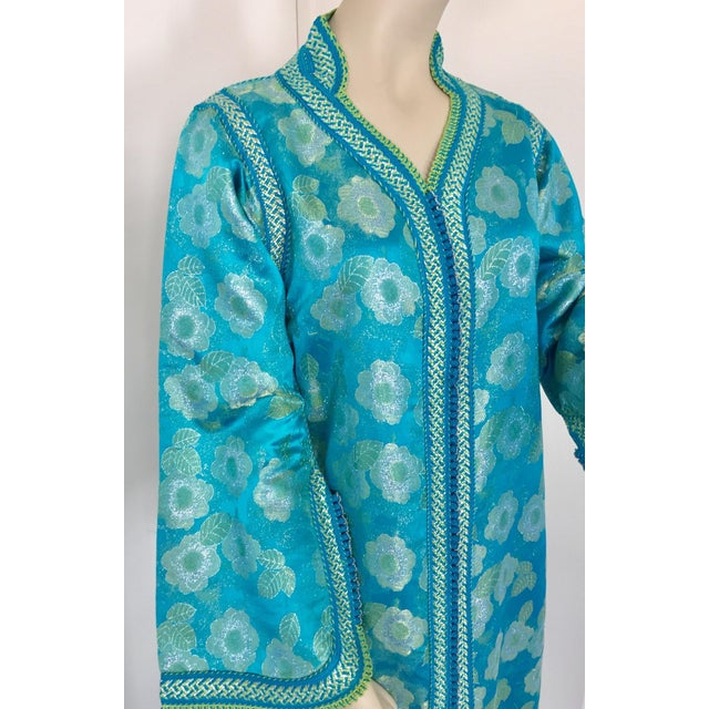 Elegant Moroccan caftan in turquoise and gold floral lame metallic and embroidered trim, circa 1970s. This long maxi dress...