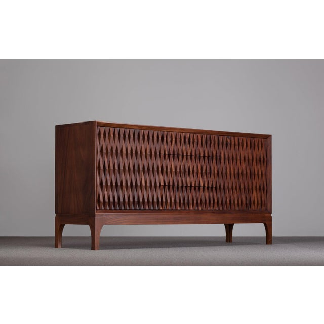 Designed to give a natural an organic tone to a modern yet nostalgic look. The credenza accentuates its two doors followed...