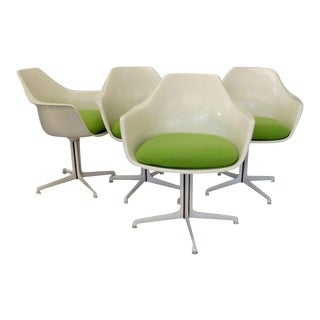 Four Burke White Fiberglass Swivel Dining Chairs