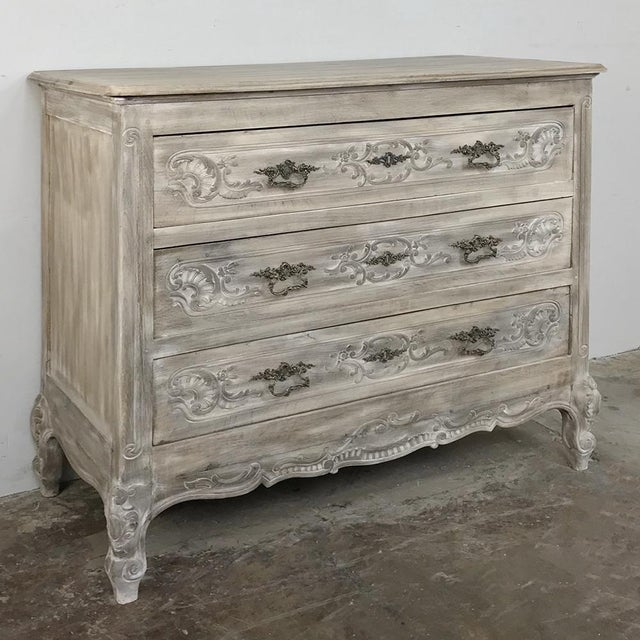 19th Century Country French Whitewashed Commode represents the essence of the breed, with finely carved facade, four...