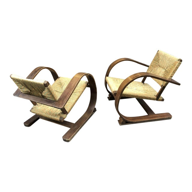 Audoux Minet Pair of Bent Wood Lounge Chair With a Rare Rush Cover For Sale