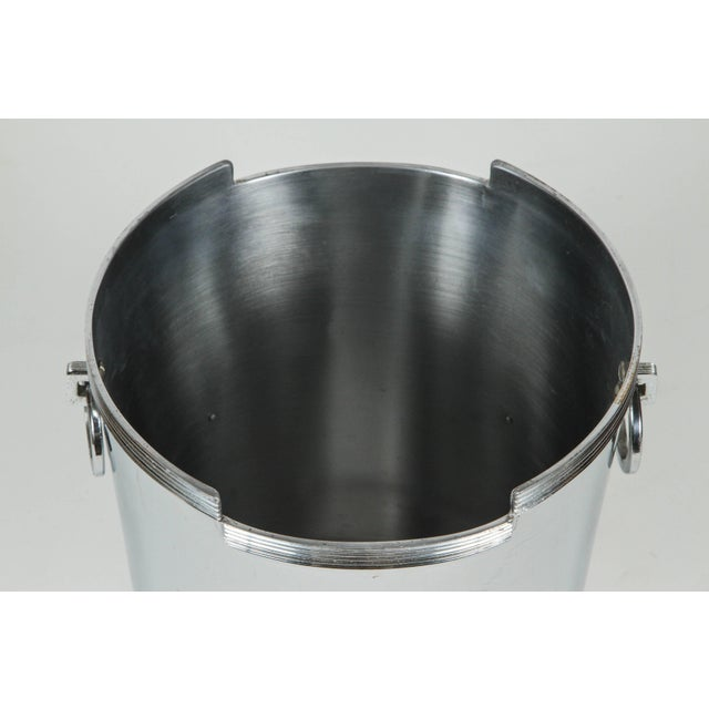 Art Deco American chrome-plated champagne Ice bucket. Geometric and fluted trim lip finished with ring handles. On one...