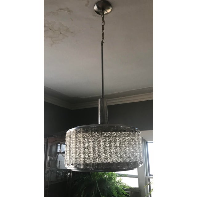 Chrome beauty, to ceiling it is 43 inches, the actual fixture is 9 inches add another 8 for top cylinder. 16 in diameter,...
