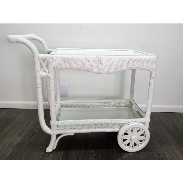 Reinvented vintage bar cart with a bright white lacquer finish. This cart has it all with a removable tray top, wooden...
