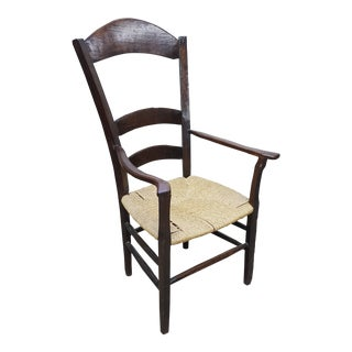 Early 19th Century French Country Ladder Back Rush Seat Arm Chair For Sale