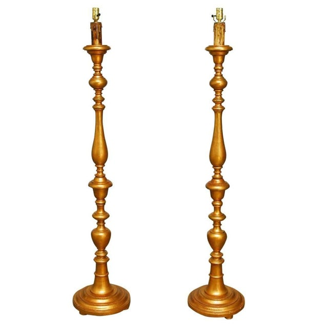 Italian Giltwood Candlestick Floor Lamps - A Pair For Sale