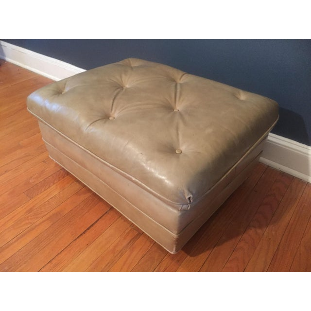 This listing is for a vintage classic Leather button tufted ottoman on wheels. Condition-naturally distressed vintage...