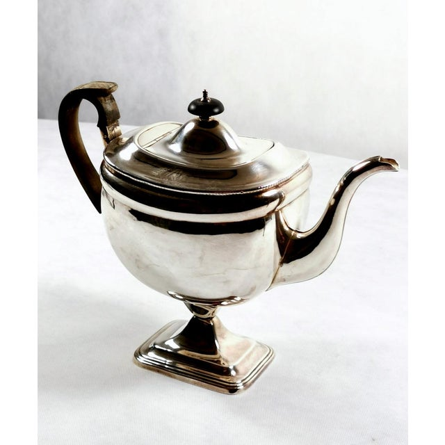 Simple and linear coffee pot in Old Sheffield Plate, the body is completely smooth and well designed, resting on a solid...
