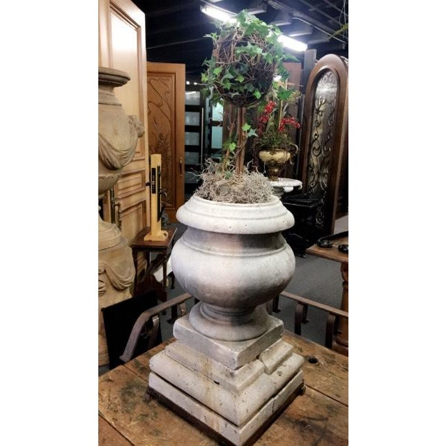 Beautifully aged 19th century French marble urn with a wrought iron base holder. This urn is ideal for enhancing the...
