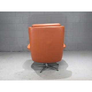 1970s Danish Modern Orange Leather High Back Swivel Armchair Preview