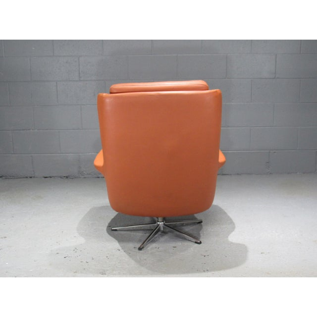 Leather high back swivel armchair. Made in the 1970s in the style of Danish Modern.