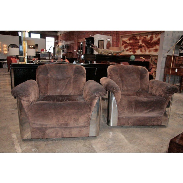 Bellissime Italian armchairs! Leather & steel; what more could you ask for.