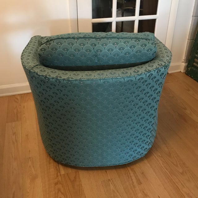 Barrel back chair on casters, separate cushions, upholstered in teal fabric. No manufacturers label.