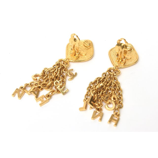 Metal Vintage Chanel Pair of Gold Plated Charm Dangle Clip on Earrings For Sale - Image 7 of 10