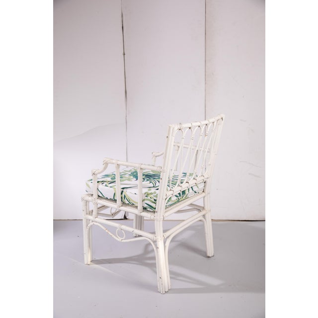 "Vintage white rattan armchair with a removable custom-made cushion in Madcap Cottage ""Bermuda Bay"" cotton fabric in Palm...."