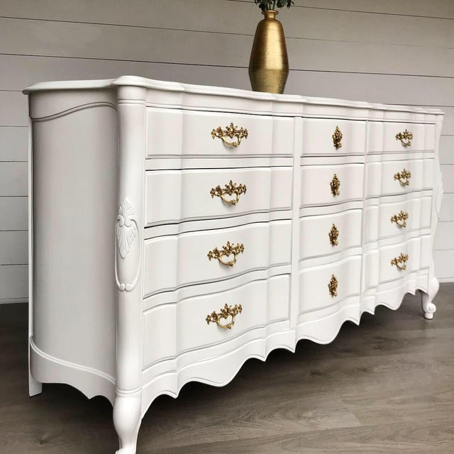 We absolutely love the new elegant look of this solid wood French Provincial Dresser. With it's 12 dovetailed drawers this...